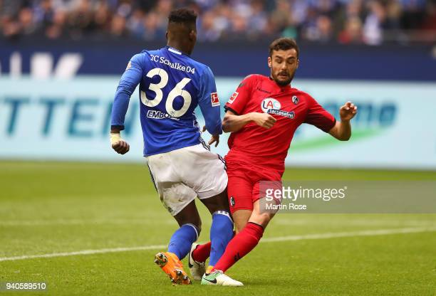 Breel Embolo of Schalke is being found by Manuel Gulde of Freiburg which leads to a penalty for Schalke during the Bundesliga match between FC...