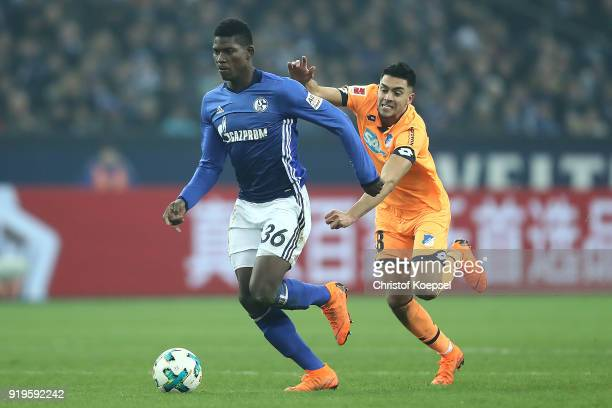 Breel Embolo of Schalke is chased by Nadiem Amiri of Hoffenheim during the Bundesliga match between FC Schalke 04 and TSG 1899 Hoffenheim at...