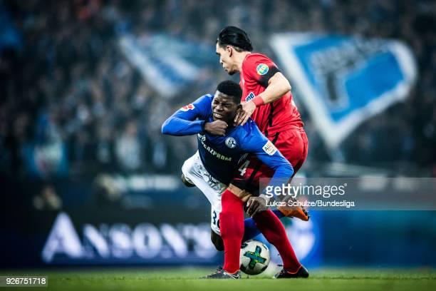 Breel Embolo of Schalke is tackled by Karim Rekik of Berlin during the Bundesliga match between FC Schalke 04 and Hertha BSC at VeltinsArena on March...