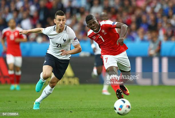 Breel Embolo of Switzerland and Laurent Koscielny of France compete for the ball during the UEFA EURO 2016 Group A match between Switzerland and...