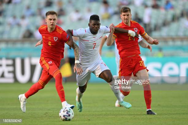 Breel Embolo of Switzerland battles for possession with Joe Rodon and Chris Mepham of Wales during the UEFA Euro 2020 Championship Group A match...
