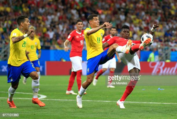 Breel Embolo of Switzerland battles for possession with Philippe Coutinho of Brazil during the 2018 FIFA World Cup Russia group E match between...