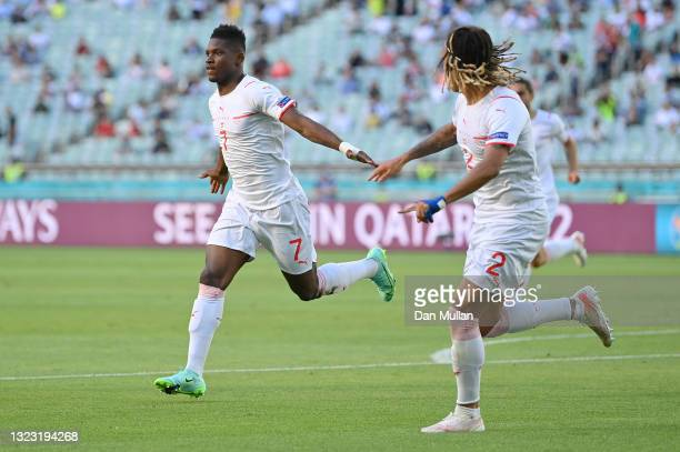 Breel Embolo of Switzerland celebrates after scoring their side's first goal during the UEFA Euro 2020 Championship Group A match between Wales and...