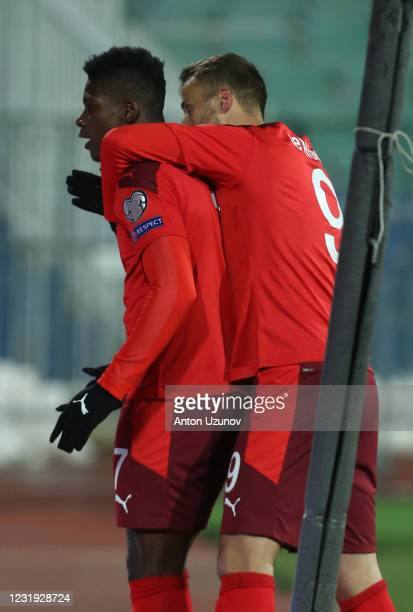 Breel Embolo of Switzerland celebrates with team-mate Haris Seferovic of Switzerland after scoring the first goal during the FIFA World Cup 2022...