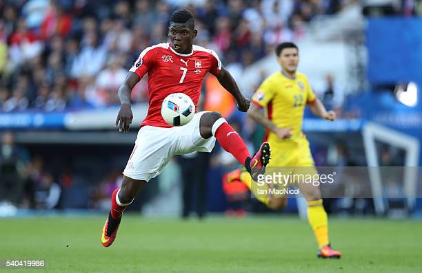 Breel Embolo of Switzerland controls the ball during the UEFA EURO 2016 Group A match between Romania and Switzerland at Parc des Princes on June 15...