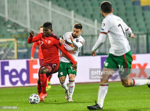 Breel Embolo of Switzerland is challenged by Kristiyan Malinov of Bulgaria during the FIFA World Cup 2022 Qatar qualifying match between Bulgaria and...
