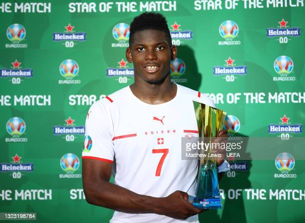 """Breel Embolo of Switzerland poses for a photograph with their Heineken """"Star of the Match"""" award after the UEFA Euro 2020 Championship Group A match..."""