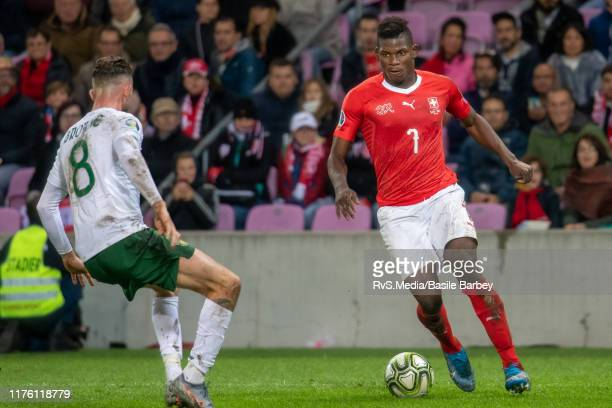 Breel Embolo of Switzerland vies for the ball with Alan Browne of Republic of Ireland during the UEFA Euro 2020 qualifier between Switzerland and...