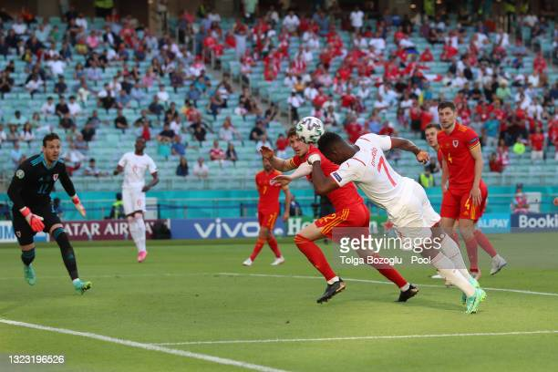 Breel Embolo of Switzerland wins a header in the box and misses during the UEFA Euro 2020 Championship Group A match between Wales and Switzerland at...
