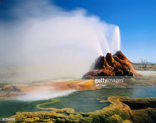breeze gently blows water spewing from geysers in the great basin. black rock desert-high rock canyon emigrant trails national conservation area, nevada. - great basin stock pictures, royalty-free photos & images