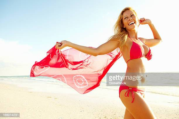 breeze on the beach - sarong stock photos and pictures