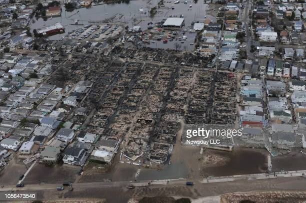 Breezy Point, Queens, N.Y.: An aerial view of the Breezy Point area of Queens, New York shows the devastation and destruction left by a fire caused...
