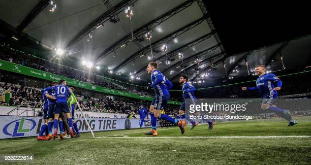 Brei Embolo of FC Schalke 04 celebrates with team mates after scoring his team's first goal during the Bundesliga match between VfL Wolfsburg and FC...