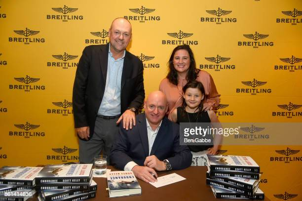 Breitling USA President Thierry Prissert and Retired Astronaut Scott Kelly pose with guests during Breitling Celebrates Former NASA Astronaut and...