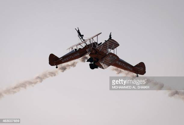 Breitling Wingwalkers display team perform during the opening of the Bahrain International Airshow 2014 in Sakhir south of the capital Manama on...