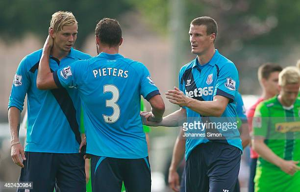 Brek Shea Erik Pieters and Robert Huth of Stoke City hug each other after the preseason friendly match between Borussia Moenchengladbach and Stoke...