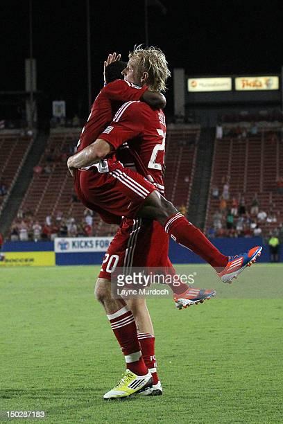 Brek Shea of FC Dallas celebrates the goal of Fabian Castillo the Colorado Rapids at FC Dallas Stadium on August 11 2012 in Frisco Texas