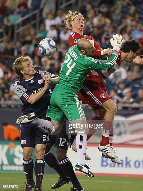 Brek Shea of FC Dallas presses goalie Preston Burpo and defender Seth Sinovic both of the New England Revolution at Gillette Stadium on May 1 2010 in...