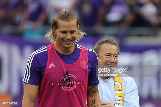 Brek Shea of Orlando City SC and head coach Adrian Heath walk to the bench prior to the start of a MLS soccer match between Sporting Kansas City and...