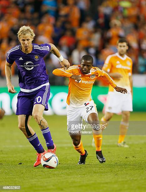 Brek Shea of Orlando City SC battles for the ball with Boniek Garcia of Houston Dynamo during their game at BBVA Compass Stadium on March 13 2015 in...