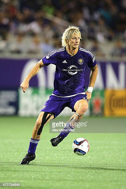 Brek Shea of Orlando City SC dribbles the ball during an MLS soccer match between the New England Revolution and the Orlando City SC at the Orlando...