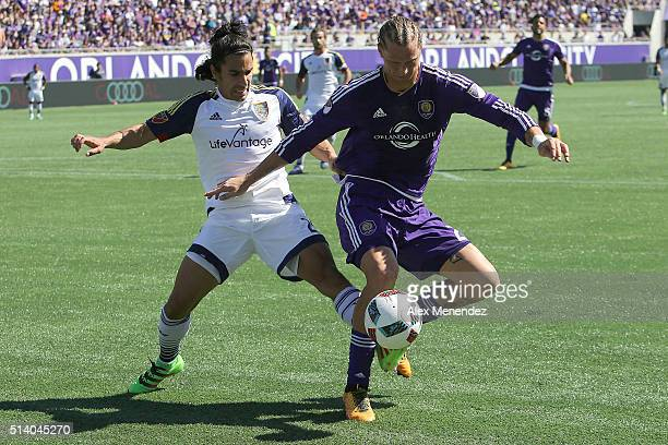 Brek Shea of Orlando City SC plays the ball against Tony Beltran of Real Salt Lake during a MLS soccer match at the Orlando Citrus Bowl on March 6...