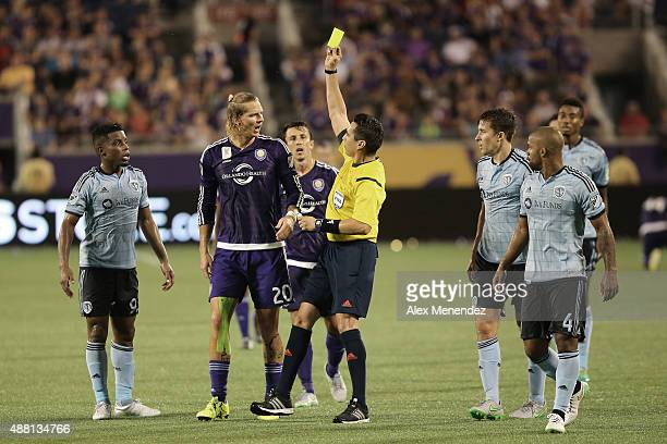 Brek Shea of Orlando City SC receives a yellow card from referee Jair Marrufo during a MLS soccer match between Sporting Kansas City and the Orlando...