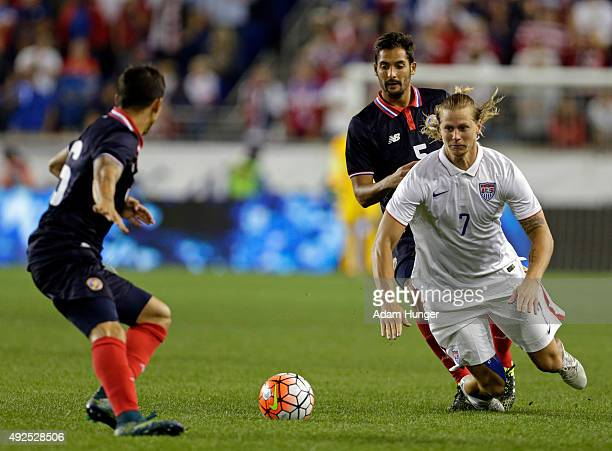 Brek Shea of the United States is tripped up by Celso Borges of Costa Rica during the second half at Red Bull Arena on October 13 2015 in Harrison...