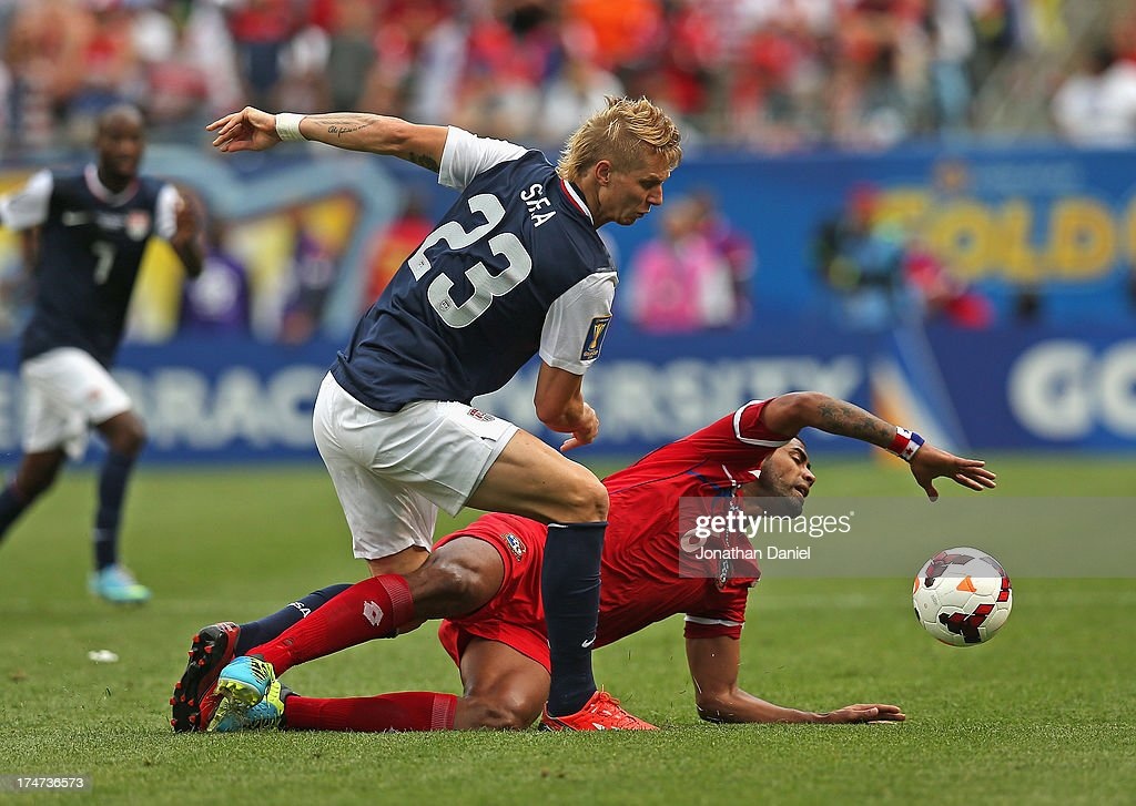 Brek Shea #23 of the United States runs over Gabriel Gomez #6 of Panama during the CONCACAF Gold Cup final match at Soldier Field on July 28, 2013 in Chicago, Illinois. The United States defeated Panama 1-0.