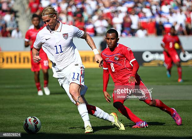 Brek Shea of the USA paces the ball on the attack as Marcos Sanchez of Panama pursues the play in the second half of their international men's...