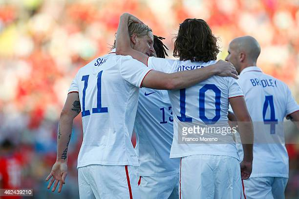 Brek Shea of USA celebrates with teammates after scoring the first goal of his team during an international friendly match between Chile and USA at...