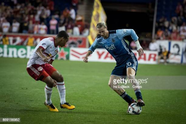 Brek Shea of Vancouver Whitecaps FC looks for the opening against Tyler Adams of New York Red Bulls during the MLS match between New York Red Bulls...