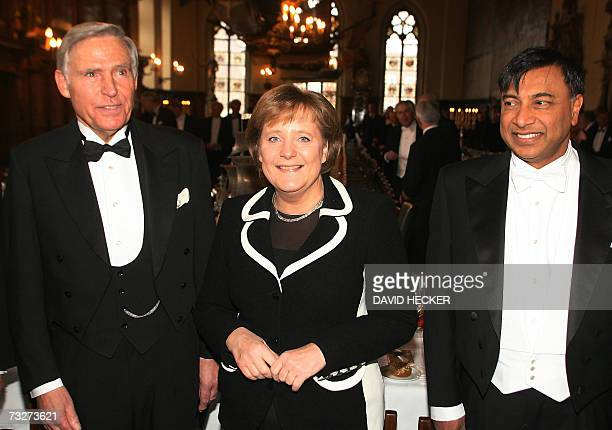 German Chancellor Angela Merkel smiles as she is flanked by Arcelor Mittal Indian CEO Lakshmi Mittal and Michael Grobien chairman of the German...