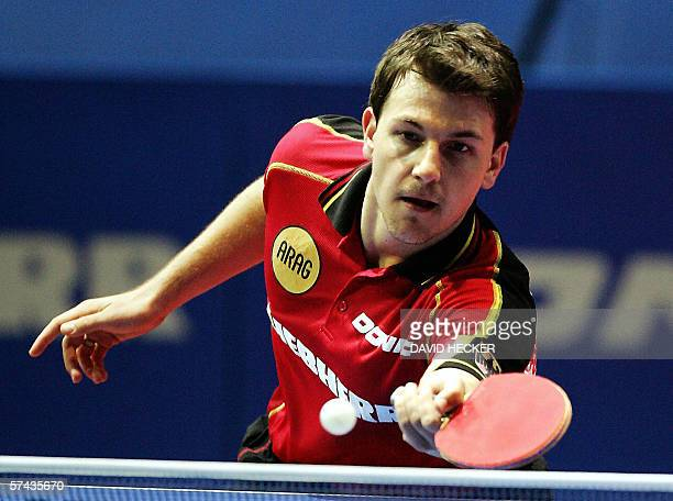 Germany's Timo Boll returns a shot to Poland's Lucjan Blaszczyk, 26 April 2006 at the AWD-Dome in Bremen, during the men's third round of the World...