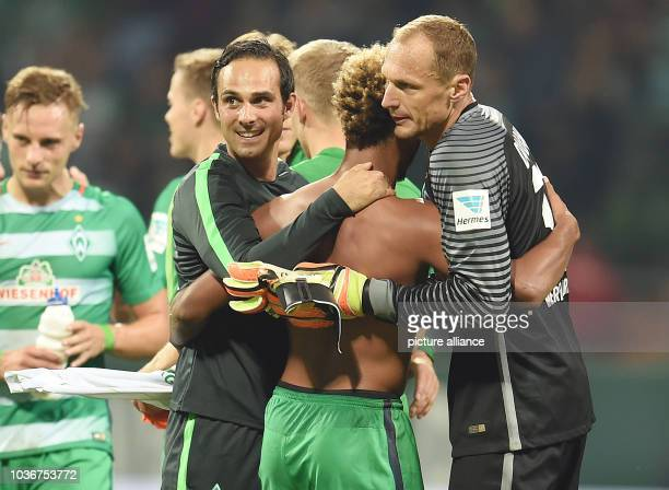 Bremen's Alexander Nouri celebrating the victory with Serge Gnabry and goalkeeper Jaroslav Drobny after the German Bundesliga soccer match between...
