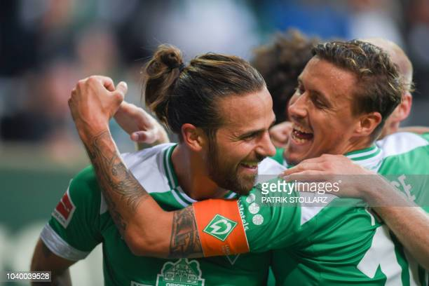 Bremen's Austrian forward Martin Harnik and Bremen's German forward Max Kruse celebrate scoring their team's first goal during the German first...