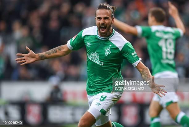 Bremen's Austrian forward Martin Harnik celebrates scoring his team's first goal during the German first division Bundesliga football match Werder...