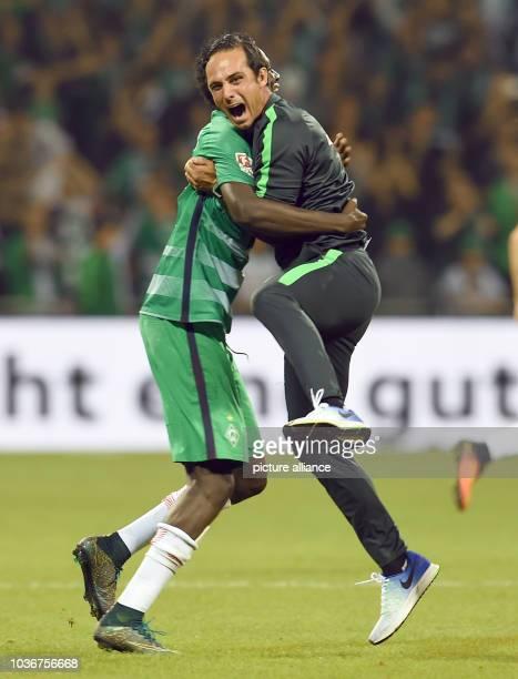 Bremen's coach Alexander Nouri and Ousman Manneh celebrating the victory after the German Bundesliga soccer match between Werder Bremen and VfL...