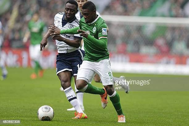 Bremen's Congolese midfielder Cedrick Makiadi and Schalke's Nigerian forward Chinedu Obasi vie for the ball during the German first division...