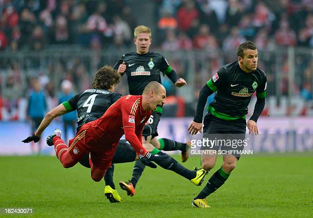Bremen's Croatian defender Mateo Pavlovic fouls Bayern Munich's Dutch midfielder Arjen Robben during the German first division Bundesliga football...