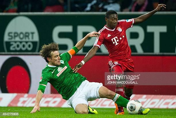 Bremen's defender Clemens Fritz vies with Bayern Munich's Austrian midfielder David Alaba during the German first division Bundesliga football match...