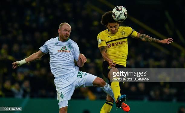 Bremen's Dutch defender Davy Klaassen and Dortmund's Belgian midfielder Axel Witsel vie for the ball during the German Cup last 16 football match BVB...