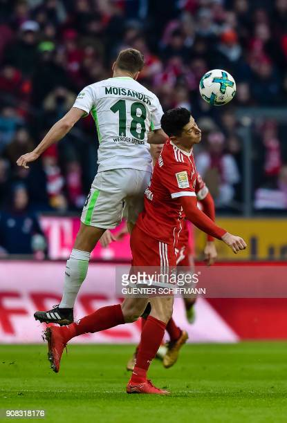 Bremen's Finnish defender Niklas Moisander and Bayern Munich's Polish striker Robert Lewandowski vie for the ball during the German first division...