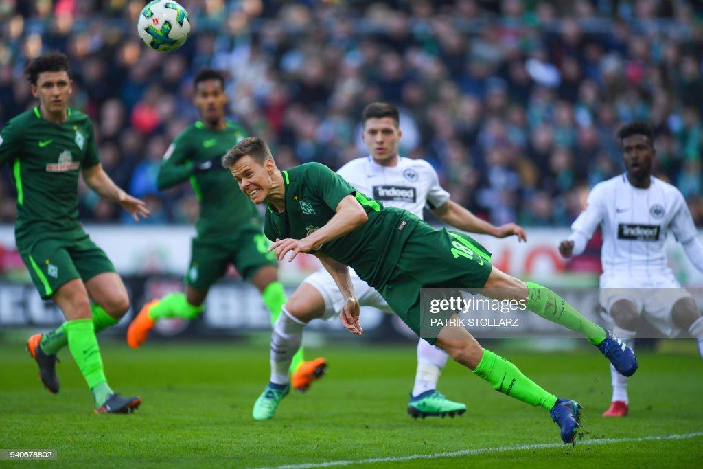 Bremen's Finnish defender Niklas Moisander plays for the ball during the German first division Bundesliga football match Werder Bremen vs Eintracht Frankfurt, in Bremen, northern Germany, on April 1, 2018. / AFP PHOTO / Patrik