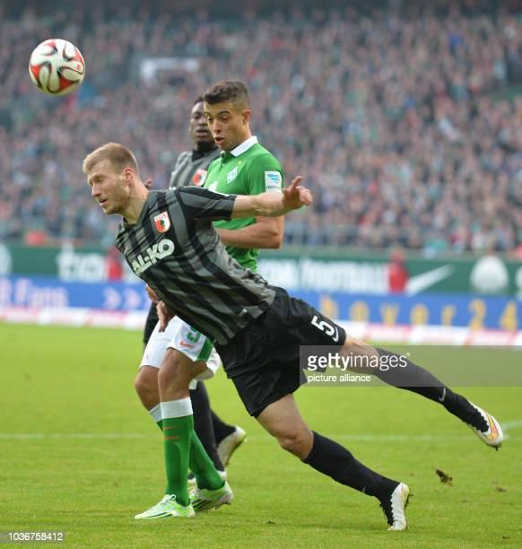 Bremen's Franco di Santo vies for the ball with Augsburg's Ragnar Klavan during the German Bundesliga soccer match between Werder Bremen and...