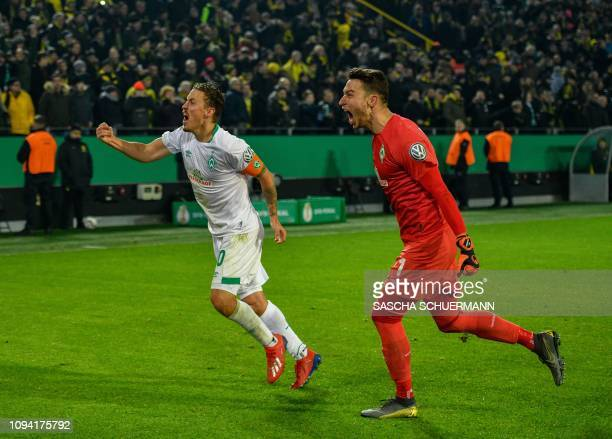 Bremen's German forward Max Kruse and Bremen's Czech goalkeeper Jiri Pavlenka celebrate after the German Cup last 16 football match BVB Borussia...