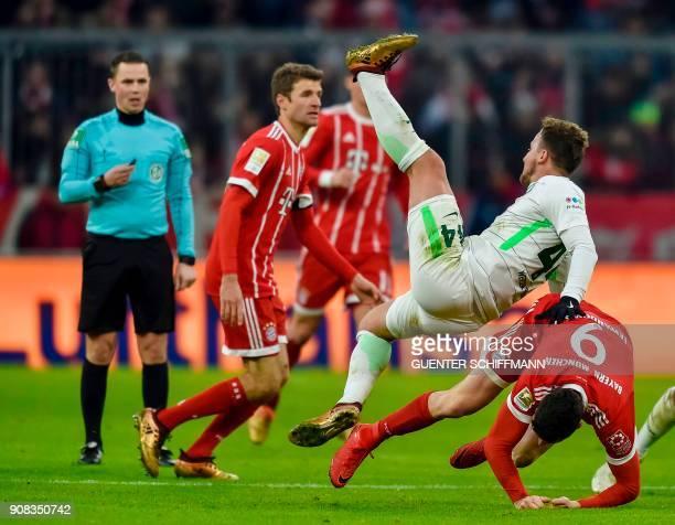 Bremen's German midfielder Philipp Bargfrede and Bayern Munich's Polish striker Robert Lewandowski fall down during the German first division...