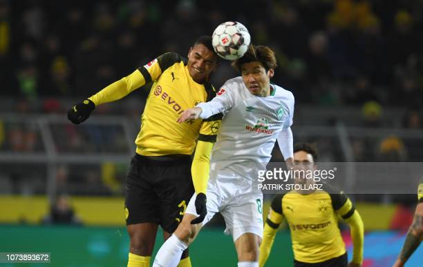 Bremen's Japanese forward Yuya Osako and Dortmund's French defender Abdou Diallo vie for the ball during the German first division Bundesliga...