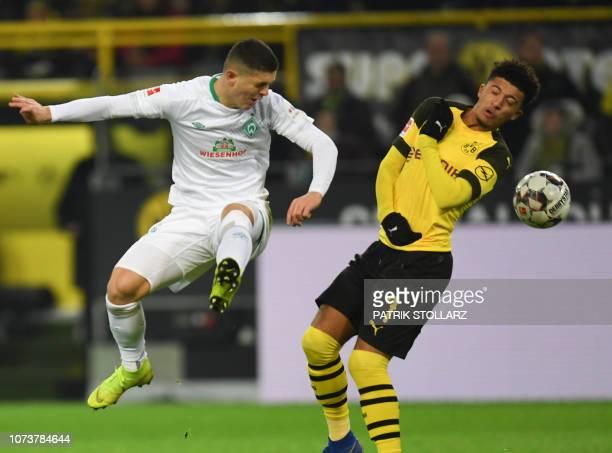 Bremen's Kosovan midfielder Milot Rashica and Dortmund's English midfielder Jadon Sancho vie for the ball during the German first division Bundesliga...