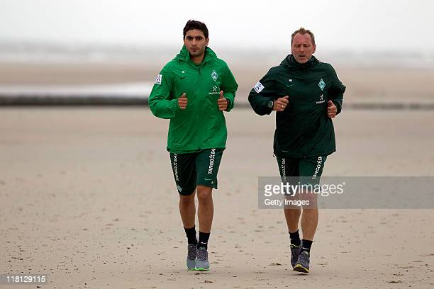 Bremen's Mehmet Ekici and Matthias Hoenerbach practice during the SV Werder Bremen training session on July 4 2011 in Norderney Germany